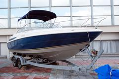 fast luxury boat ready for transport - stock photo