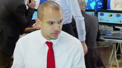 Time lapse of diverse team of financial traders at work in a busy office Stock Footage