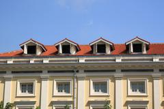 Gable on the roof townhouse in city. Stock Photos