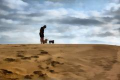 painting boy standing with dogs on dune - stock illustration
