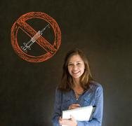 no drugs woman on blackboard background - stock photo