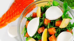 Salad with salmon in transparent bowl Stock Footage