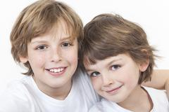 happy boy children brothers smiling together - stock photo