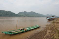 the wooden long tail boats at mekong river, Laos. - stock photo