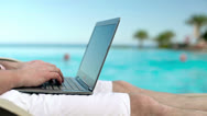 Stock Video Footage of 9Man hands working with laptop by the swimming pool, steadycam shot