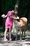 girl and sika deer 1 - stock photo