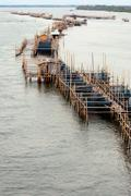 Stock Photo of aquaculture fishery pond in entrance river.