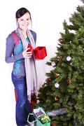 beautiful girl by the christmas tree - stock photo