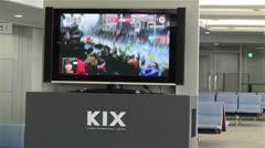 Boston Marathon Massacre News on TV in Kanasai Airport Osaka Japan 2 handheld Stock Footage