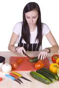 Stock Photo of cute teenager preparing food