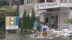 Children Play in the Flood Water p186 Stock Footage