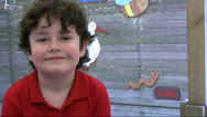 Stock Video Footage of Little boy smiling to camera