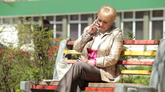 Senior lady talking on the phone outdoors - stock footage