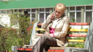 Stock Video Footage of Senior lady talking on the phone outdoors
