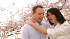 Mature husband lifting is happy wife for a kiss Stock Footage