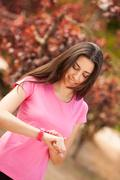 Sport woman cheking her watch Stock Photos