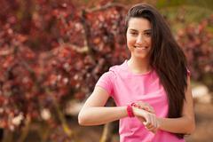 sport woman cheking her watch - stock photo