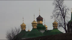 dome of the Orthodox church and the monument to the victims of famine - stock footage