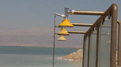 Shower at the Dead Sea coast Stock Footage