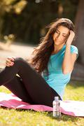 young beautiful sport woman about to drink water - stock photo