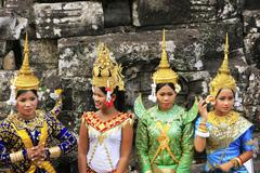 apsara dancers performing at bayon temple - stock photo