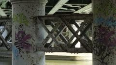 River under bridge with graffati Stock Footage