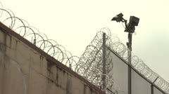 Jail 7 Barbed Wire exteriors - Two Clips In One Stock Footage