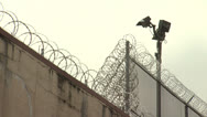 Stock Video Footage of Jail 7 Barbed Wire exteriors - Two Clips In One