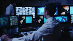 Stock Video Footage of Security personnel working in system control room.