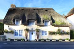 thatched cottage dorset - stock photo