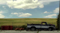 Pan shot of wrecked old and newer vehicles Stock Footage