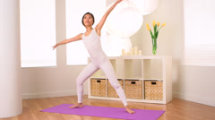 Cute Chinese woman doing yoga pose: Extended side Angle - stock footage