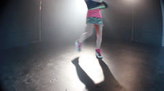 Attractive girl with charming smile and execute a dance on stage Stock Footage