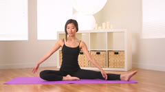 Oriental woman doing yoga Stock Footage