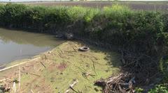 Farmland, illegal trash dump old tires Stock Footage