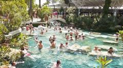 People swim in Cleopatra pools near Pamukkale, Turkey Stock Footage