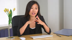 Stock Video Footage of Asian businesswoman explaining concepts to business partners