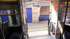 Travelling by train in the UK. Train door closes. Stock Footage