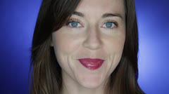 Stylish young woman does an amused facial expression with corner of lip Stock Footage