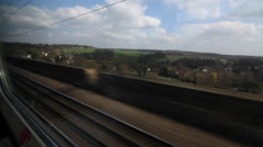 Travelling by train in the UK. Fields and station. Stock Footage