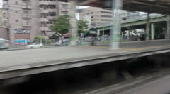 Shinkansen passing stations and small towns of Tokyo suburb, Japan Stock Footage