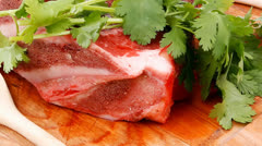 Pork big rib and fillet with garlic and green stuff Stock Footage