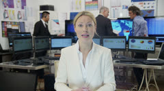 Beautiful businesswoman takes a conference call Stock Footage