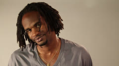 "An adult modern geezer whirls and says ""Ha"" with an amused smile Stock Footage"