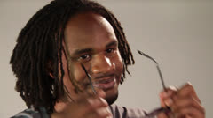 An adult stylish dude wears a black color Spectacle and gently touches his chin Stock Footage