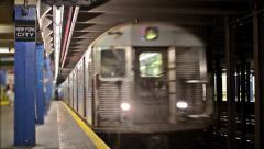 NYC Subway Train Pulls into Station - New York City Sign MTA Platform Stock Footage
