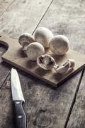 Mushrooms on the cutting board Stock Photos
