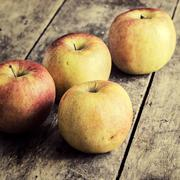 Ripe apples on a dark wooden table Stock Photos