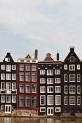 Row of canal houses in amsterdam Stock Photos