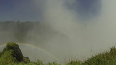 Rainbow by Victoria Falls with Rising Mist and Grass Stock Footage